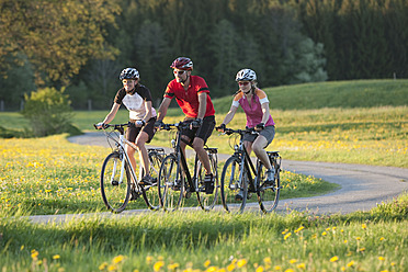 Germany, Bavaria, Man and women riding bicycle - DSF000550