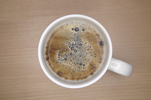 Cup of coffee on table, close up - TCF002317