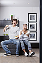 Germany, Bavaria, Young couple watching TV - MAEF004626