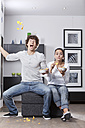 Germany, Bavaria, Young couple watching TV - MAEF004628