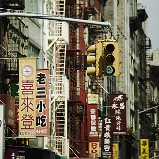 USA, New York, Traffic light and business flags in Chinatown - TL000636
