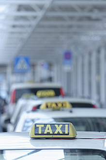 Europe, Germany, Bavaria, Munich, Row of taxis at airport - TCF002354