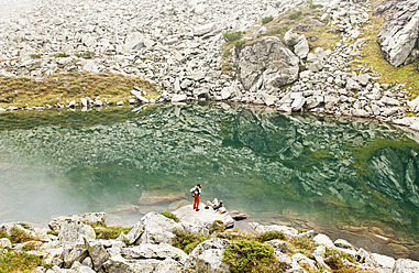 Austria, Styria, Man and woman having rest at Lake Obersee - HHF004082
