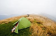Austria, Styria, Man and woman walking on way  to summit at Reiteralm - HHF004088