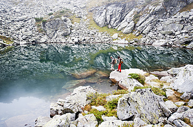 Austria, Styria, Man and woman standing at Lake Obersee - HHF004091