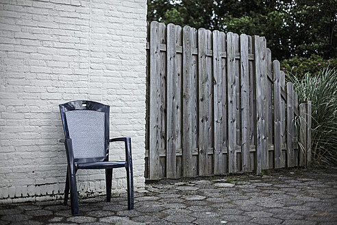Netherlands, Chair against brick wall - DWF000160