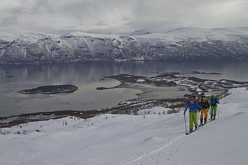 Norway, Lyngen, Skiers walking uphill - FFF001303