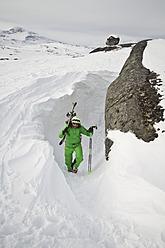 Sweden, Skier walking uphill - FFF001290