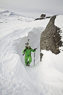 Sweden, Skier walking uphill - FFF001290