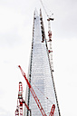 England, London, View of The Shard consturction with cranes - JM000148