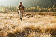 Austria, Salzburg, Young woman running in autumn - HHF004164