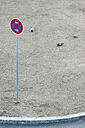 Germany, Bavaria, Munich, Road sign with pigeons in background - LFF000458