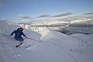 Norway, Mature man skiing on step mountain - FFF001309