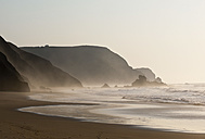 Portugal, Algarve, Sagres, View of beach at sunset - MIRF000422
