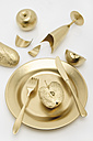 Golden cutlery with apple and bread on white background - MUF001207