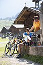 Austria, Tyrol, Man and woman at water pump - DSF000603