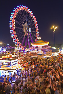 Germany, Baden Wuerttemberg, Stuttgart, People at fairground celebrating traditional festival - WD001197