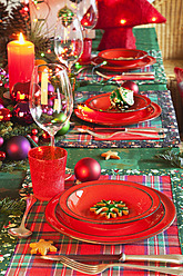 Germany, Cologne, Place setting at dining table for christmas - GWF001789