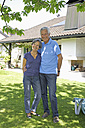 Germany, Bavaria, Senior couple standing in yard, smiling - TCF002623