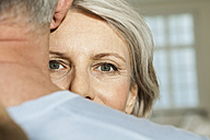 Germany, Berlin, Senior couple embracing, close up - FMKYF000048