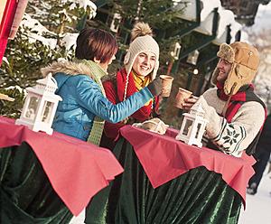 Austria, Salzburg, Man and women at christmas market, smiling - HHF004209