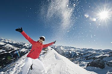 Austria, Salzburg, Young woman on top of mountain - HHF004203