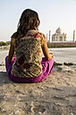 India, Agra, Young woman looking at Taj Mahal - MBEF000339