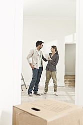 Germany, Berlin, Mature couple inspecting new house - FMKYF000153