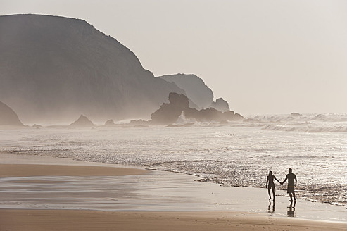 Portugal, Couple walking on beach - MIRF000462