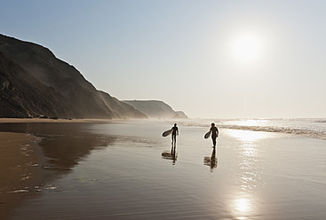 Portugal, Couple walking with surfboard on beach - MIRF000465
