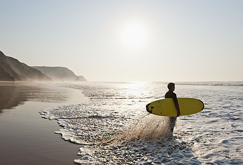 Portugal, Surfer on beach - MIRF000471