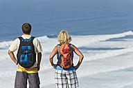 Portugal, Man and woman looking at Atlantic Coast - MIRF000477