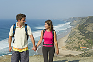 Portugal, Couple walking on beach - MIRF000480