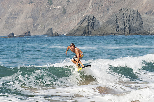 Portugal, Surfer surfing on waves - MIRF000486