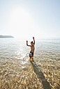 Portugal, Boy standing in water at beach - MIRF000495