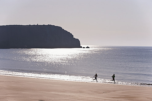 Portugal, Man and woman running on beach - MIRF000501