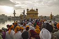 India, Punjab, Amritsar, People waiting at entry of Golden Temple - MBE000347