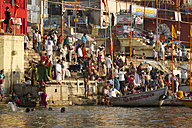 India, Uttar Pradesh, Varanasi, People taking morning bath and washing clothes at River Ganges - MBE000360