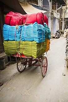India, Amritsar, Colourful cotton textile on riksha - MBE000384
