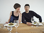 Germany, Cologne, Man and woman having dinner, portrait - RHYF000153