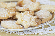 Plate of Christmas biscuits on doily - GWF001841