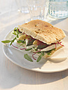 Focaccia asparagus sandwich with buffalo mozarella and rocket on plate - KSWF000888