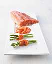 Salmon with wild asparagus on plate, close up - KSWF000951