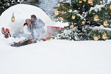 Austria, Salzburg County, Couple celebrating christmas in nature, smiling - HHF004268