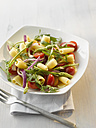 Plate of pasta salad with campanelle and wild asparagus, close up - KSWF000960