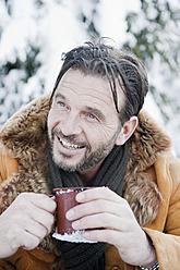 Austria, Salzburg County, Mature man drinking tea, smiling - HHF004278