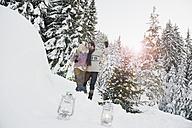 Austria, Salzburg County, Couple celebrating christmas in snowy landscape - HHF004292