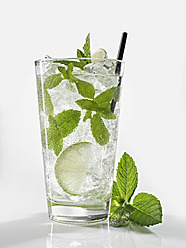 Glass of mojito with mint on white background, close up - KSWF000991