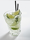 Glass of mojito with mint on white background, close up - KSWF000990