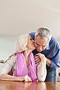 Germany, Leipzig, Senior woman kissing to man - WESTF018770